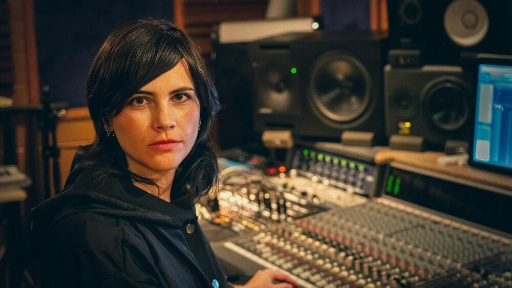 Maria Elisa Ayerbe audio engineer behind a mixing console